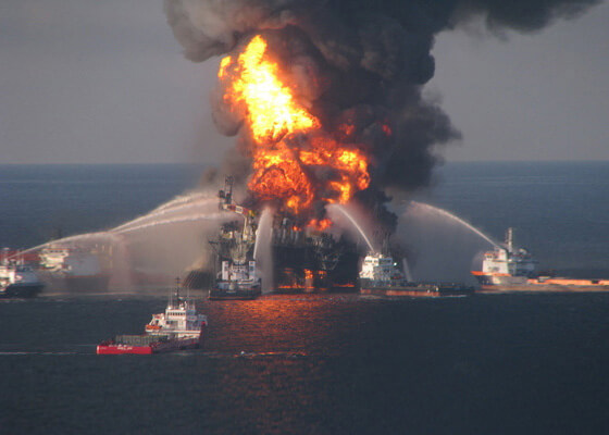 Fire boat response crews battle the blazing remnants of the offshore oil rig Deepwater Horizon image